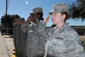 saluting female service member